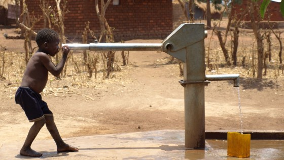 Malawi - boy and borehole - Boy and borehole with water